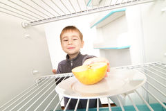 Boy Looks Empty Refrigerator Royalty Free Stock Photography