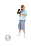 The boy looks through the field-glass at the globe Stock Photography