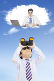 Boy looks at future job with binoculars Royalty Free Stock Images