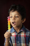 Boy looks at the gel candy Stock Photography