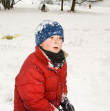 Boy looks happy from playing in the snow Stock Photography