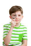 The boy looks through loupe Royalty Free Stock Photo