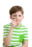 The boy looks through loupe Royalty Free Stock Photo