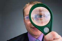 Boy looks through magnifier Stock Image
