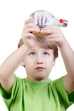 Boy looks at miniature model of tallship in bottle Royalty Free Stock Photo