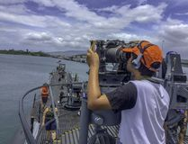 Boy looks through navy binoculars on board submarine stock photos