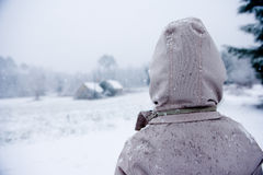 Boy looks out over a wintry landscape. Dordogne France Stock Photography