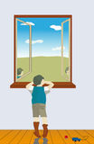 The boy looks out of the window Royalty Free Stock Image