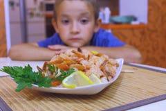 Boy looks at shrimp Royalty Free Stock Photography