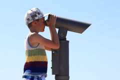 The boy looks in a terrestrial telescope Royalty Free Stock Photography