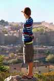 Boy looks to town. From view point he look to Avila monument stock photography
