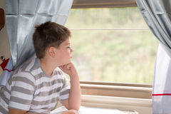 Boy looks in train window Royalty Free Stock Photography