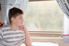 Boy looks in train window Royalty Free Stock Image