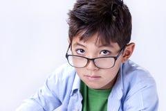 Boy looks up at camera. Royalty Free Stock Photography