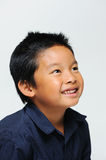 Boy Looks Up Smiling Royalty Free Stock Photo
