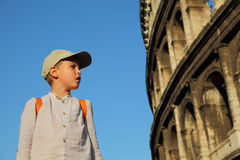 Boy looks at walls of the Coliseum Stock Images