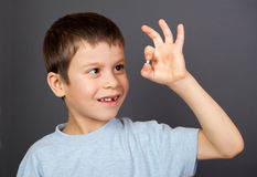 Boy with lost tooth on thread Royalty Free Stock Images