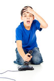 Boy lost in a video game Royalty Free Stock Image
