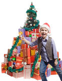 Boy and a lot of gifts Royalty Free Stock Photo