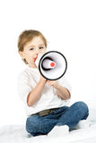 Boy with loud speaker. A studio view of a young boy holding a portable, hand-held loud speaker Stock Photos