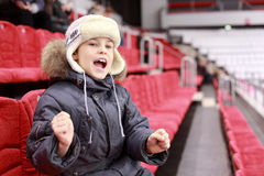 Boy loudly shouts on  hockey match Stock Images