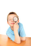 Boy with loupe Royalty Free Stock Photo