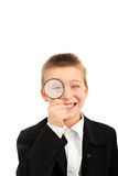 Boy with loupe Royalty Free Stock Image