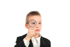 Boy with loupe Stock Images