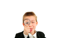 Boy with loupe Stock Image