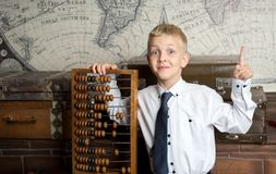 Boy love count. Handsome boy holding big ancient wooden abacus calculation. conceptual idea about modern education system. a guy dreams of his future profession Stock Images