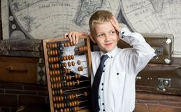 Boy love count. Handsome boy holding big ancient wooden abacus calculation. conceptual idea about modern education system. a guy dreams of his future profession Stock Photography