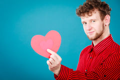 Boy in love with red heart. Love and help from people. Charming lovely man with red paper heart persuade to be good helpful hopeful. Valentines Day or charity Stock Photos