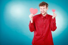 Boy in love with red heart royalty free stock photos