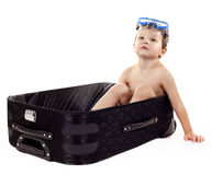 Boy in the luggage Stock Photo