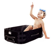 Boy in the luggage stock image
