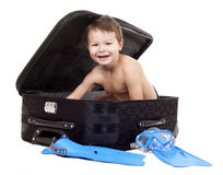 Boy in the luggage Stock Photos
