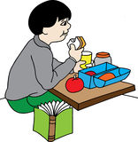 Boy at lunch Royalty Free Stock Photos