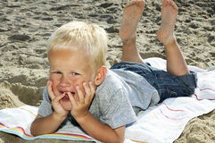 Boy Lying On A Beach Royalty Free Stock Image