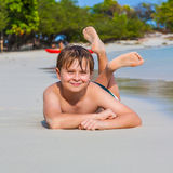 Boy is lying at the beach Royalty Free Stock Photo