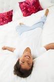 Boy Lying On Bed Wearing Pajamas Royalty Free Stock Photo