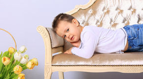 Boy lying on a bench Royalty Free Stock Images