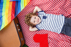 Boy lying on blanket looking at camera Stock Photo