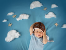 Boy lying on blanket with white clouds Royalty Free Stock Image