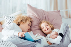 Boy lying with book royalty free stock photos