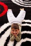 Boy lying on the carpet Royalty Free Stock Image