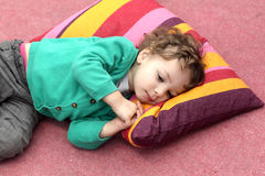 Boy is lying on carpet Royalty Free Stock Image