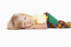 Boy lying down, looking Royalty Free Stock Image