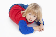 Boy lying down, looking at camera Royalty Free Stock Image