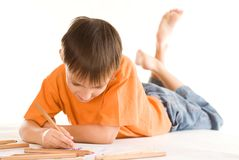 Boy lying and draw Royalty Free Stock Images