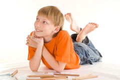 Boy lying  and draw Stock Image